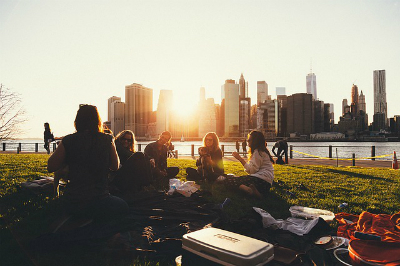 picnic with friends on the grass | living with allergies | Perpetual Wellbeing