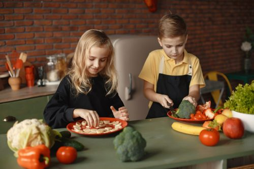 children slicing veg | How to get your child to eat fruits and veggies | Perpetual Wellbeing