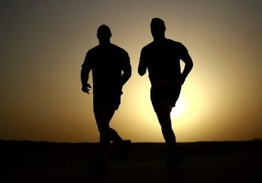silhouette of 2 men running | mens health supplements that work | Perpetual Wellbeing